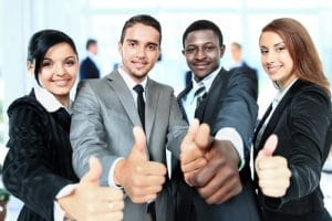 Group of business people thumbing up