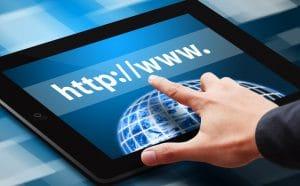 Hand press on web link on tablet