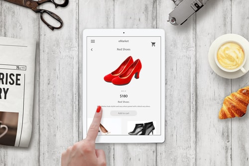 Woman online shopping red shoes with tablet